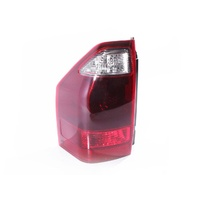 Mitsubishi Pajero 02-06 NP Wagon Dark Red & Clear LHS Left Body Tail Light